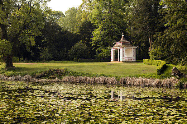 Chinese Summerhouse, Wrest Park, Silsoe, Central Bedfordshire. The garden building from the north-east, with Broad Water in the foreground, May 2017. Chinese temple