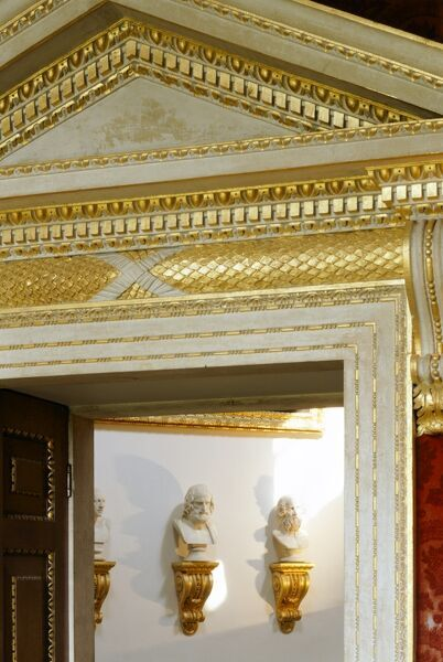 CHISWICK HOUSE, London. Interior detail of the Red Velvet Room doorway looking towards three of the busts in the Tribunal or Saloon