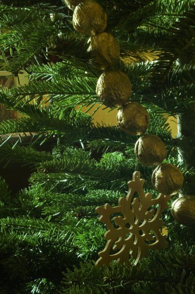 ELTHAM PALACE, London. Decorations hanging from a Christmas tree