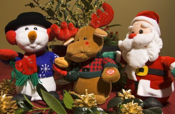 Christmas themed soft toys including a singing snowman, reindeer and father christmas