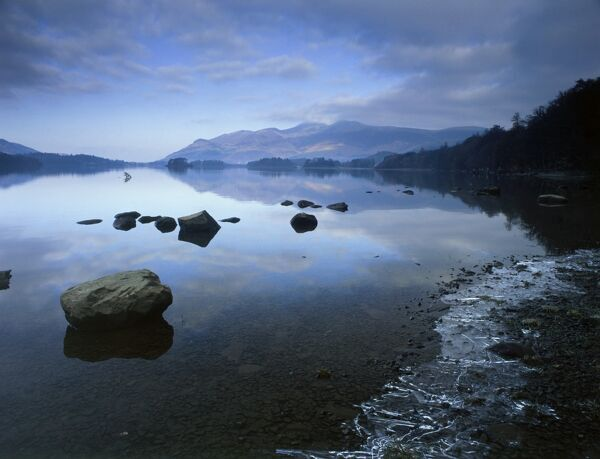 DERWENTWATER, Lake District National Park, Cumbria. View across the water showing an ice formation on the right. derwent