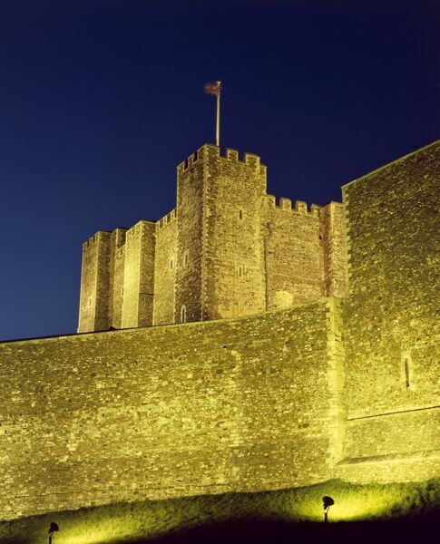 DOVER CASTLE, Kent. Night view looking up at the floodlit Keep