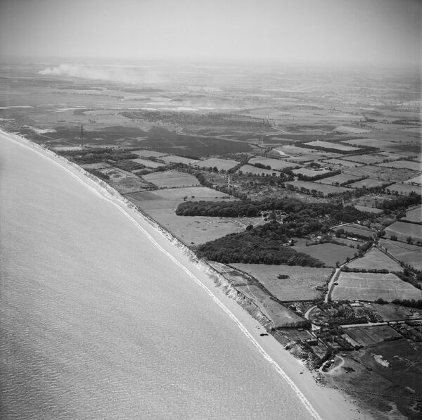 The village and the Common, Dunwich, Suffolk, from the north-east. This view includes numerous anti-invasion defences. Photographed by Aerofilms Ltd in July 1949