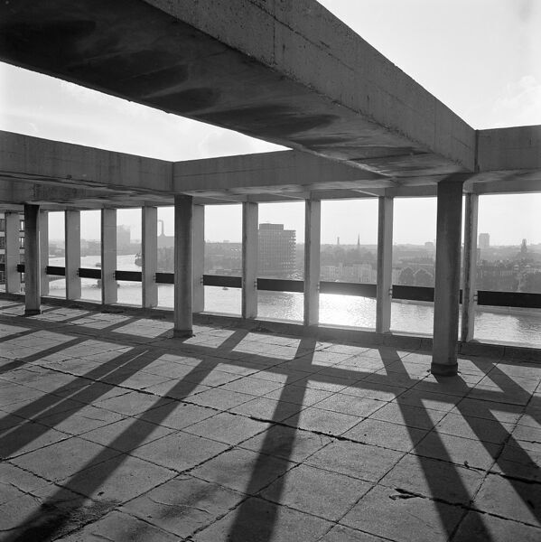 EASTBURY HOUSE, Lambeth, London. The Thames seen through the concrete beams forming the roof of Eastbury House on the Albert Embankment in Lambeth, with the skyline of Westminster visible on the opposite bank. Photographed by John Gay. Date range