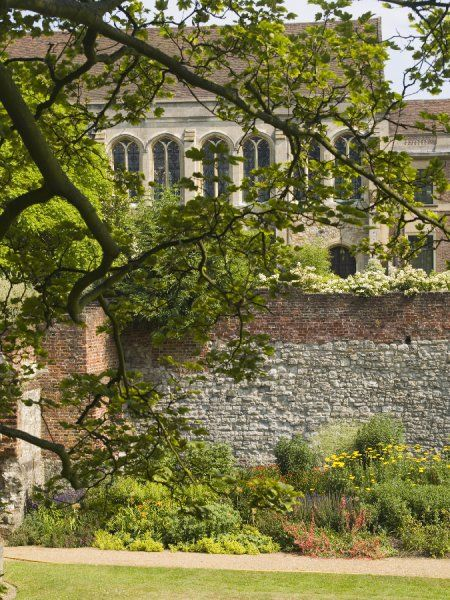 ELTHAM PALACE, Greenwich, London. A view of the Great Hall through the trees