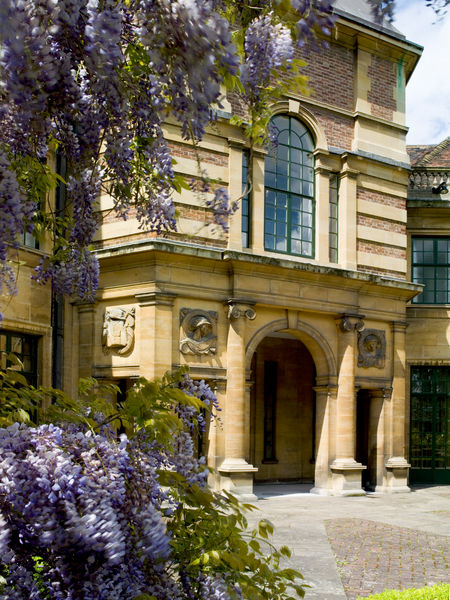 ELTHAM PALACE, London. View of the loggia entrance with blooming flowers