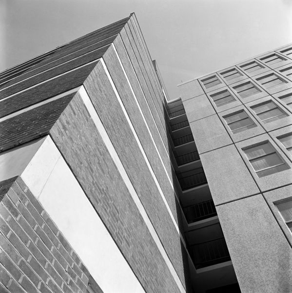 EMANUEL HOUSE, London. A close up exterior showing part of the Emanuel House development in Westminster looking up from street level in Greencoat Place towards the point at which Rochester Row Garage joins the Emanual House flats. Photographed by John Gay