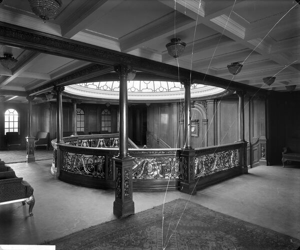 Fractured glass plate negative. Looking aft in the 1st class entrance to A deck, RMS Olympic, White Star Line, 1920-21