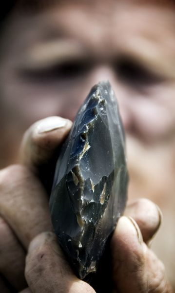 GRIMES GRAVES, Norfolk. Flint knapping demonstration. Detailed view of a flint during knapping