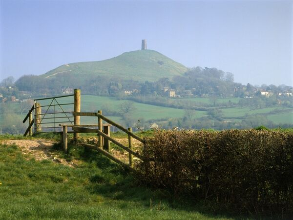 GLASTONBURY TOR, Somerset. Looking north from east across stile towards distant tor