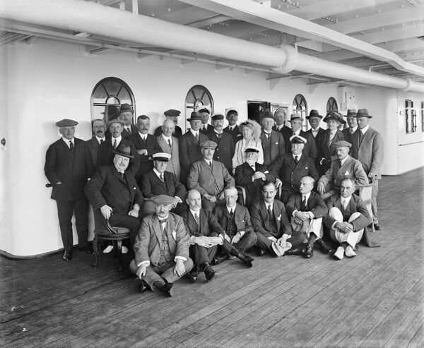 A group posed on the deck of RMS Olympic, White Star Line, 1920