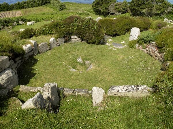 HALANGY DOWN ANCIENT VILLAGE, St Mary's, Isles of Scilly. Remains of the Iron Age village. View of circular house with stone walls and hearth