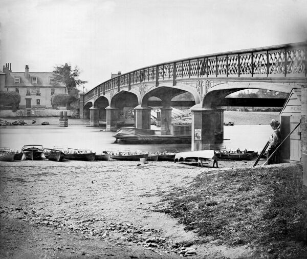 HAMPTON COURT BRIDGE, Richmond Upon Thames, London. Looking toward the third bridge over the Thames at the site, designed by E.T. Murray, built between 1864 and 1866. The fourth and present bridge was built in 1930 and designed by Edward Lutyens