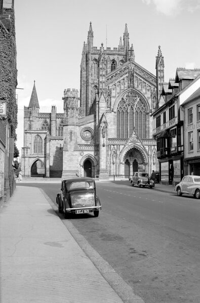 HEREFORD CATHEDRAL, Hereford, Herefordshire. An exterior view looking towards the west front of the Cathedral from King Street. The west front was built by Oldrid Scott. Photographed by Stanley W Rawlings. Date range: 1945 - 1965