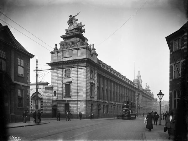 Guildhall, Alfred Gelder Street, City Of Kingston Upon Hull. Exterior view from the south-west of the Guildhall, with pedestrians and a tram in the street. By Sir Edwin Cooper of Russell, Cooper & Davis (1906-1914), it is now listed Grade II*