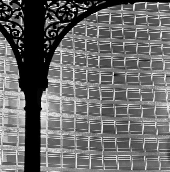 LONDON BRIDGE STATION, London. A close up of a cast iron spandrel at the station, with a modern office block visible beyond. Photographed by John Gay. Date range: 1960-1972