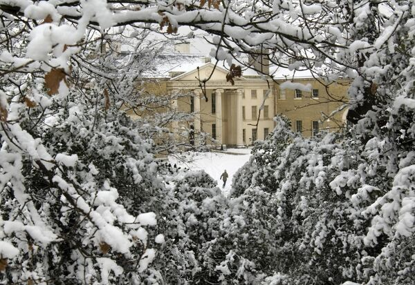 KENWOOD HOUSE, London. Exterior view. Kenwood House in the snow through trees