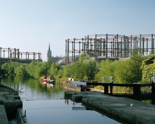 KINGS CROSS GAS HOLDERS, London. View from the canal looking south with St Pancras Station in the distance