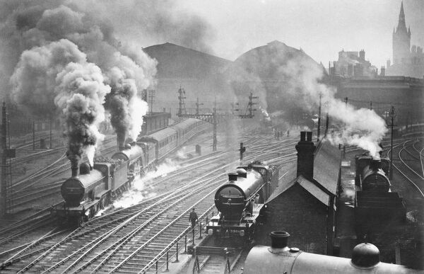 King's Cross Station, Euston Road, London. Steam trains departing the station. Photographed circa 1925