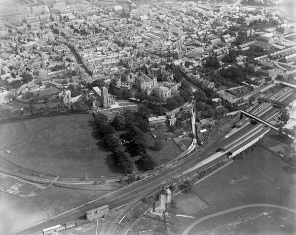 LANCASTER, Lancashire. Aerial view of Lancaster with the Castle, church and railway station. Lancaster Castle houses the Shire Hall and County Court and until 2011 it was used as a prison. The castle keep dates from the 12th century. Photographed in July 1920
