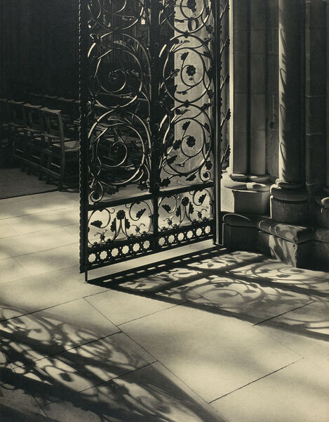 Lichfield Cathedral, Staffordshire. Interior view. Shadow of the wrought iron gates in the stone floor in the south choir aisle. Photographed, c. mid-1950s, by Margaret F. Harker, who entitled it 'Light and Shadow'
