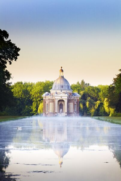 WREST PARK HOUSE AND GARDENS, Bedfordshire. The Long Water with the Pavilion designed by Thomas Archer