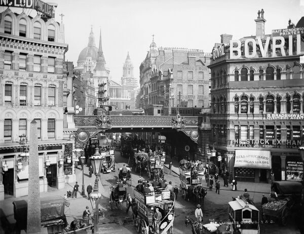 LUDGATE CIRCUS, City of London. A busy street view of Ludgate Circus looking towards St Paul's Cathedral with horse-drawn buses in the foreground and a steam train on the bridge