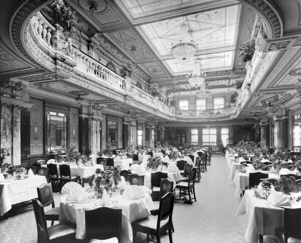 THE POPULAR CAFE, Piccadilly, London. Restaurant interior from the entrance with tables set and ready for customers. The start of a new restaurant venture for Lyons, the Popular Cafe opened to the public on 10 October 1904 with seating for 2000