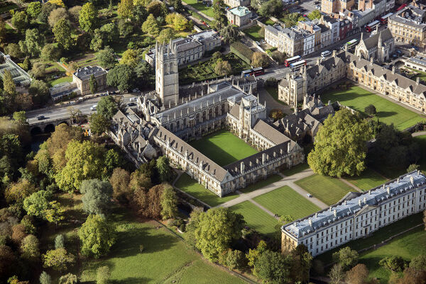 Magdalen College, Oxford. Aerial photograph taken in October 2017, showing Magdalen Bridge (over the River Cherwell), the college quad and the 15th century Bell Tower with the botanic gardens beyond