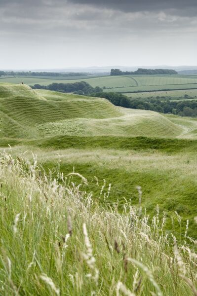 MAIDEN CASTLE. Dorset. Iron Age hill fort. View of ramparts to south east from the west