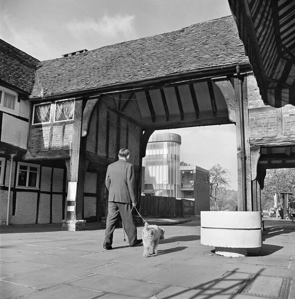 40-46 HIGH STREET, Godalming, Surrey. A man and his dog walking through the rear range of numbers 40 to 46 High Street, Godalming; constructed in the 20th century reusing earlier timbers. Photographed by John Gay. Date range: 1969-1973