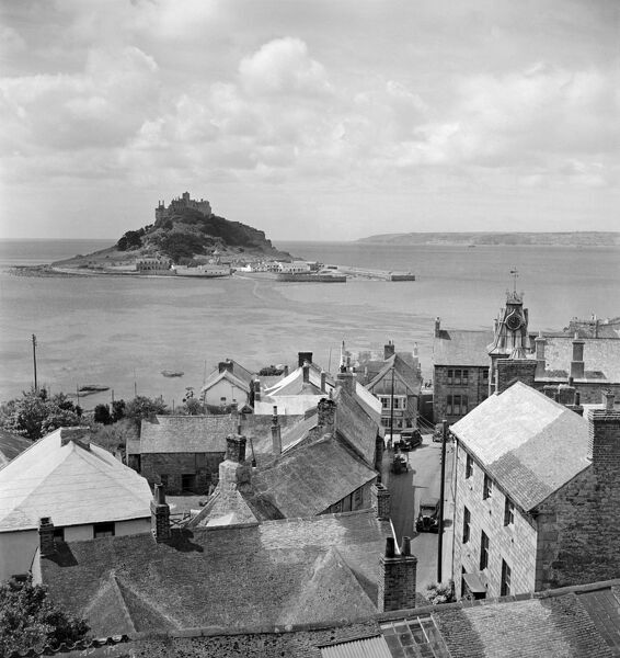 MARAZION, Cornwall. A view over the rooftops of Marazion to St Michaels Mount, taken during the photographer's holiday to Cornwall. Photographed by John Gay in 1950