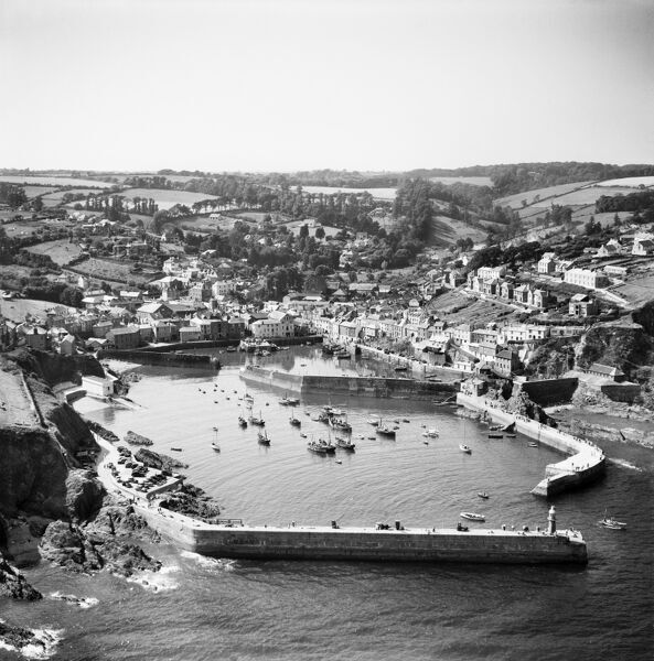 The village, Victoria Pier and the harbour, Mevagissey, Cornwall, from the south-east. Photographed by Aerofilms Ltd in 1953