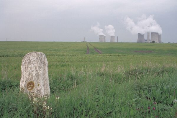 View of Oxfordshire countryside showing milestone in foreground and Didcot Power Station beyond. IoE 249968