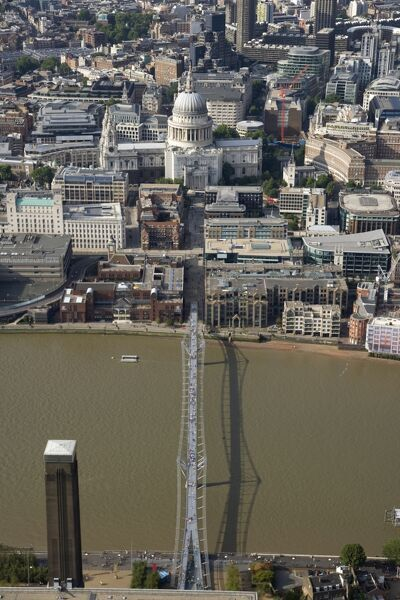 MILLENNIUM BRIDGE, London. An aerial view of the bridge and St Paul's Cathedral. The pedestrian walkway connects the City and Southwark across the River Thames. Tate Modern's chimney can be seen in the forground