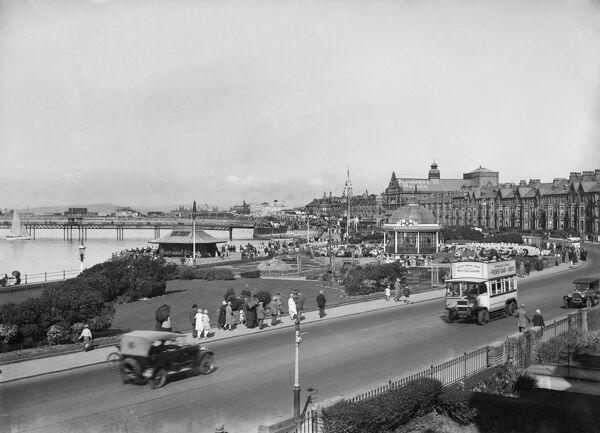 Marine Road West, West End, Morecambe, Lancashire. The West End seafront from the south, with cars and a bus in the foreground. Walter Scott