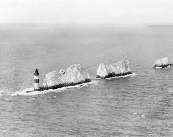 THE NEEDLES, Isle of Wight. Early aerial view of this famous landmark of chalk stacks rising out of the sea, culminating in the Needles Lighthouse (1859). Photographed in April 1920. Aerofilms Collection (see Links). EPW000793