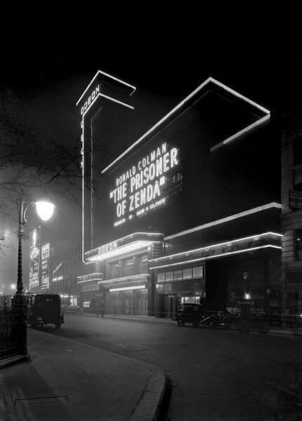 ODEON CINEMA, Leicester Square, London. A view of the cinema at night. 1937. John Maltby