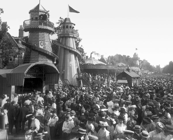 OXFORD, Oxfordshire. The Collins Helter Skelters standing in St Giles' during the annual fair held at the beginning of September in 1907, with a large crowd gathered outside. Henry Taunt