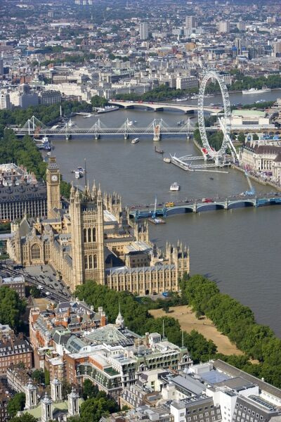 PALACE OF WESTMINSTER, London. Aerial view of the Houses of Parliament, River Thames and London Eye wheel