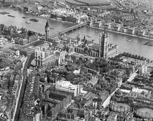 PALACE OF WESTMINSTER, London. An aerial view of the River Thames, Westminster Abbey and the Houses of Parliament in 1921. Aerofilms Collection (see Links)