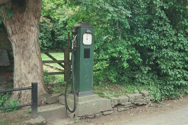 c1935. Square steel petrol pump standing on chamfered and stepped concrete base. Oxton, Nottinghamshire. IoE 475079