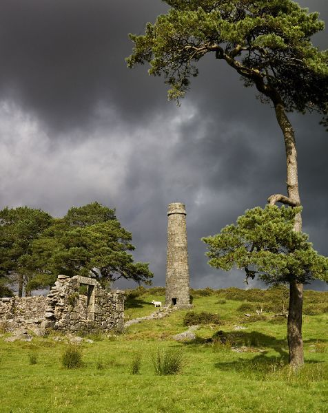 DARTMOOR, Devon. Remains of the Powder Mills at Postbridge, showing chimney and ruined building against an overcast sky
