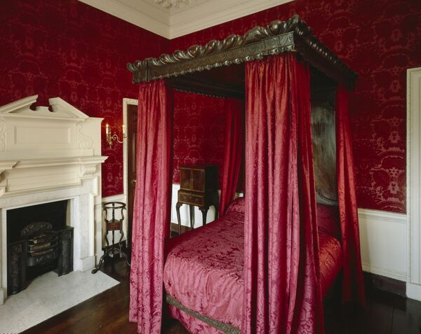 MARBLE HILL HOUSE, Middlesex. View of The Red Damask Bedchamber showing the bedstead and fireplace