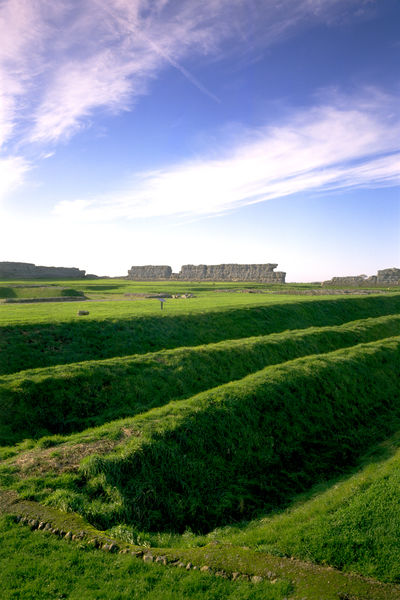 RICHBOROUGH ROMAN FORT, Kent. A general view across the site showing the triple ditches of the third century fort