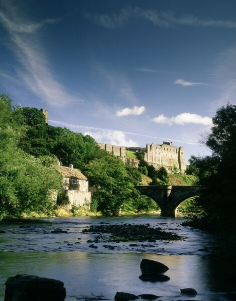 RICHMOND CASTLE, North Yorkshire. View from the River Swale towards the castle and bridge