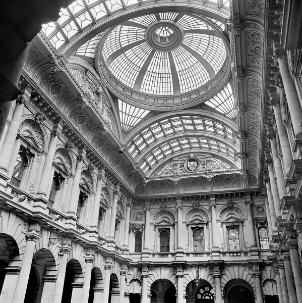 ROYAL EXCHANGE, City of London. An interior view of the elaborate vaulted and domed cast iron and glass roof and pedimented Ionic first floor windows of the Royal Exchange. Photographed by John Gay. Date range: 1960-1975