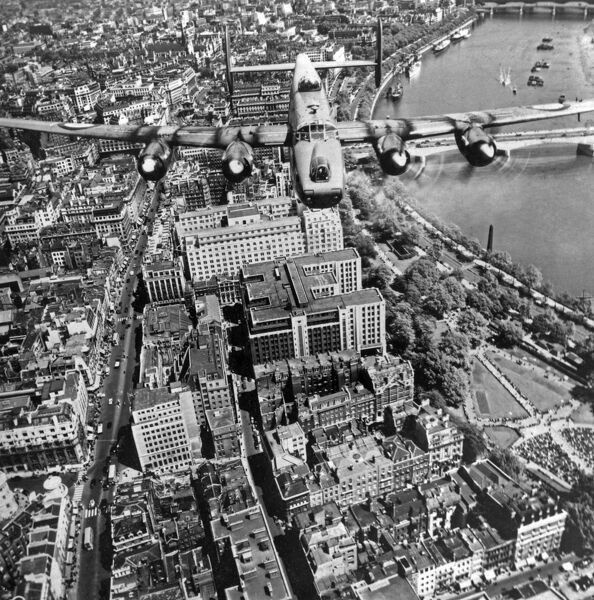 An aerial view looking down on an Avro Shackleton Mark II bomber in flight over the Strand as part of a fly-by celebrating Queen Elizabeth II's birthday. RAF photography 1956