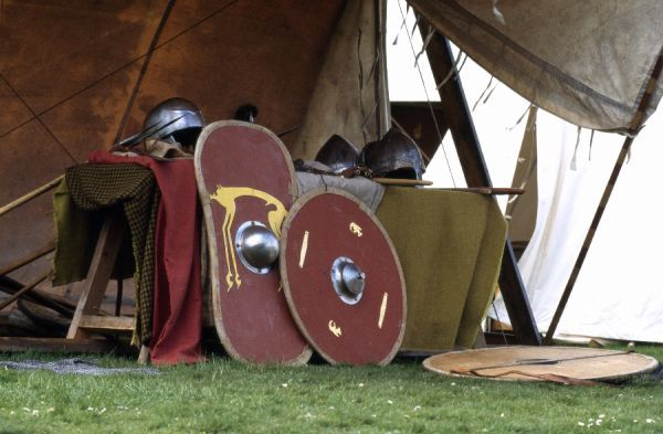 OLD SARUM, Wiltshire. Saxons & Vikings re-enactment event, 25 May 1996. Shields and helmet. Regia Anglorum