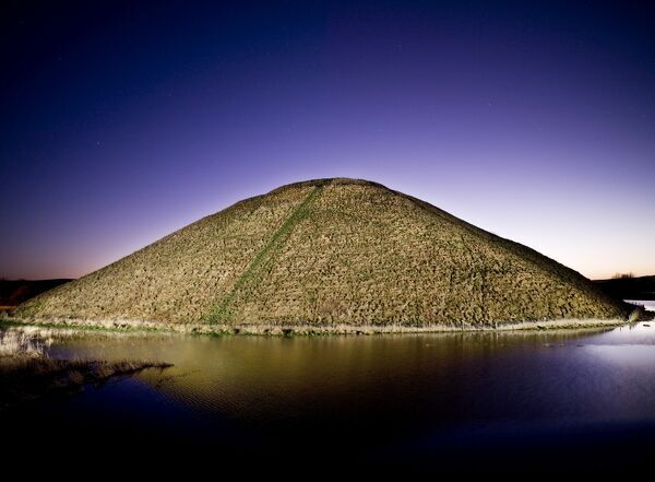 SILBURY HILL, Wiltshire. Silbury Hill lit at dusk / night. Part of the Avebury World Heritage Site